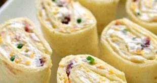 These Bacon Cheddar Ranch Pinwheels are the perfect party food! Loaded with baco...